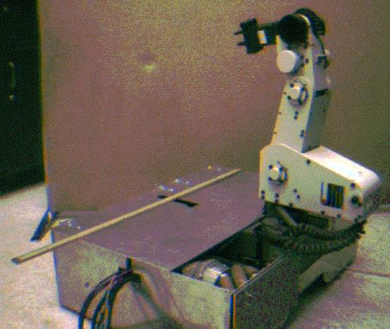 A picture of a mobile robot with a Mitsubishi arm