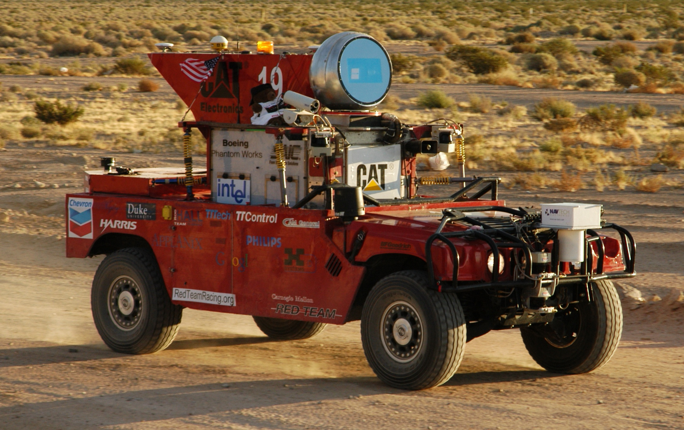 darpa challenge Team ensco's autonomous vehicle malfunctions during darpa grand challenge in 2004 darpa we may not be zipping around in self-driving.