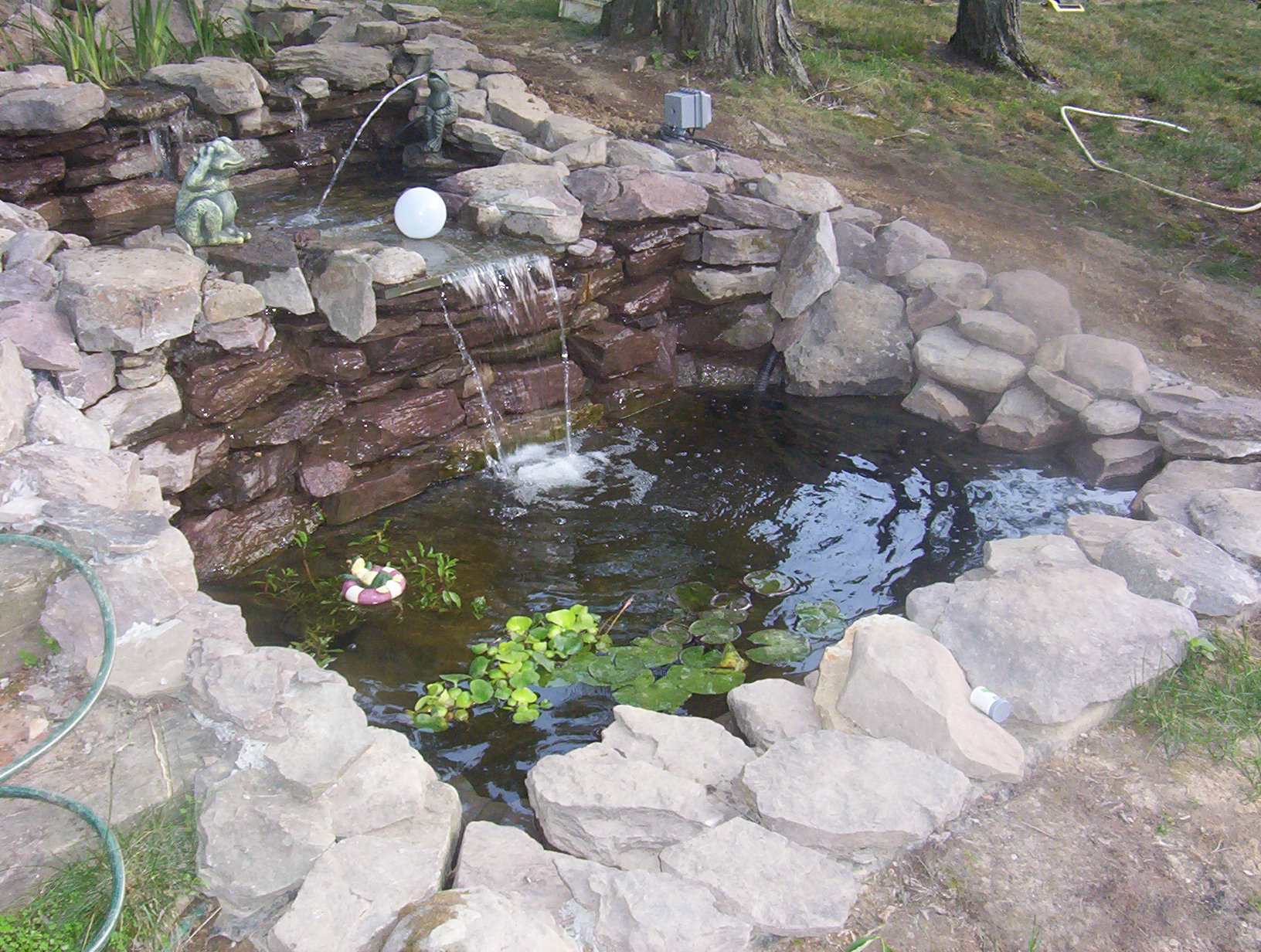 Construction of simmons family fish pond 2006 2007 for Concrete fish pond construction and design
