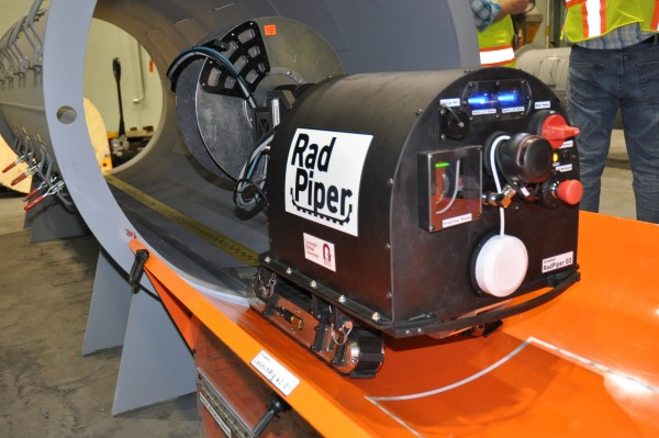 RadPiper uranium-detecting robot is launched into a section of test pipe at the U.S. Department of Energy's Portsmouth Gaseous Diffusion Plant in Ohio