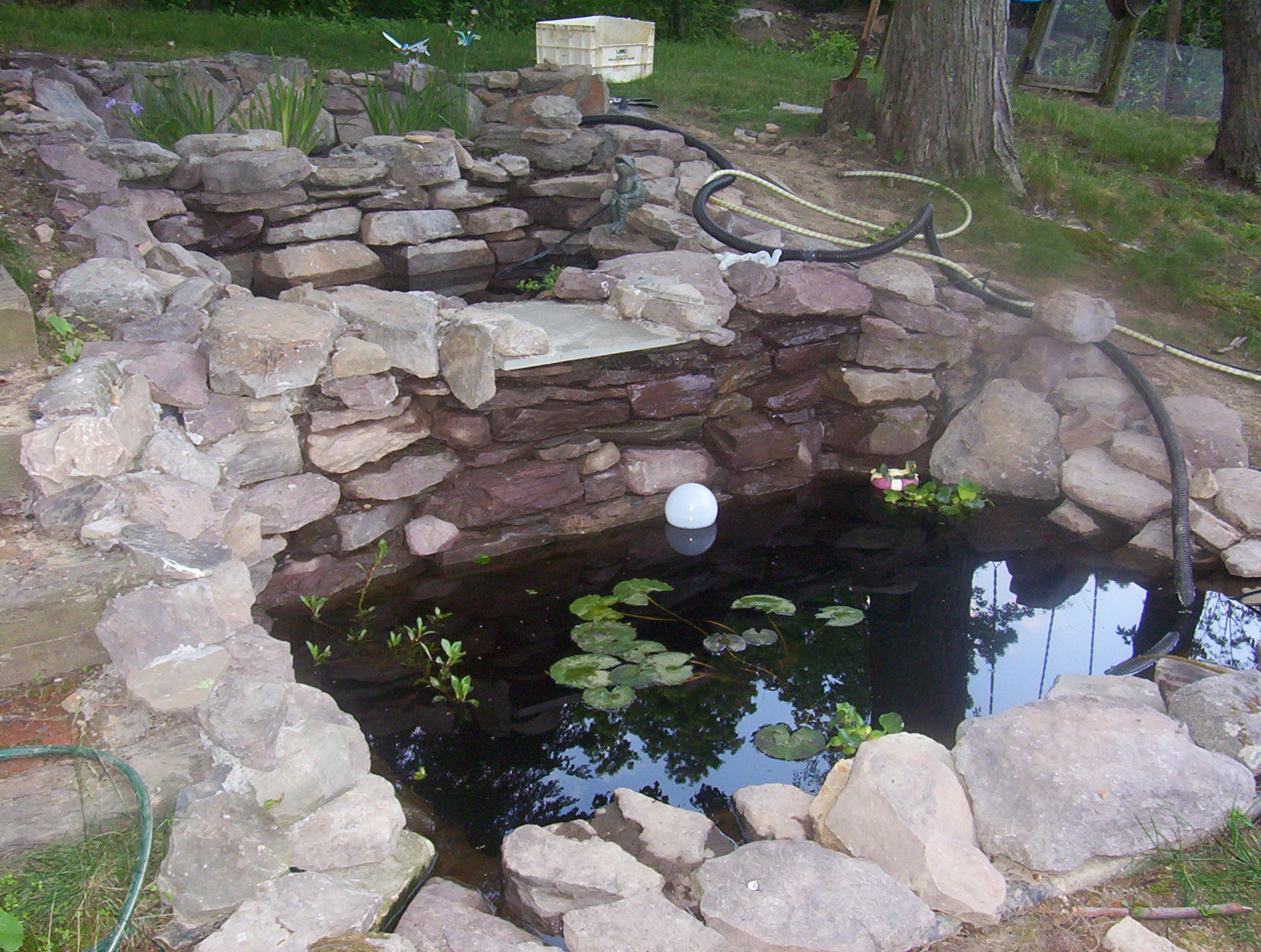 Construction of simmons family fish pond 2006 2007 for Stone koi pond